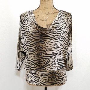 Animal print dolman style top • L👀K!!